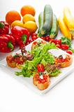 original Italian fresh bruschetta served with fresh salad and ve
