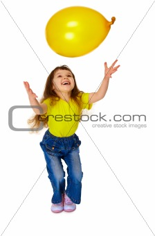 Little girl chasing balloon on white background