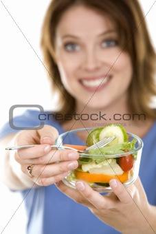 casual woman eating salad