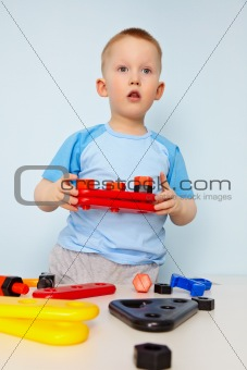 Kid plays with toy parts