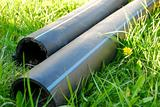 construction pipes lying on the grass during contruction