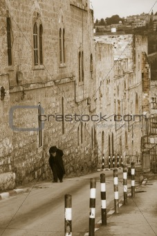 Elderly  jewish man climbing to the Old City of Jerusalem