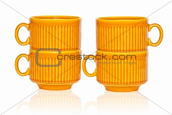 Four ceramic coffee cups isolated on white background