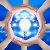 light bulb in women hand making a circle