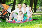 Family at park relaxing and have fun