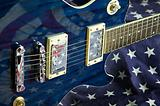 Blue Guitar on Flag Background