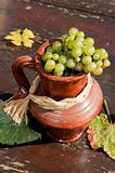 Ceramic jug with wine grape