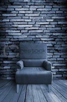 old single sofa seat in front of the wall