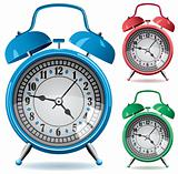 set of colorful retro alarm clocks