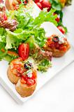 original Italian fresh bruschetta served with fresh salad and