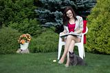 Woman in the yard reading book
