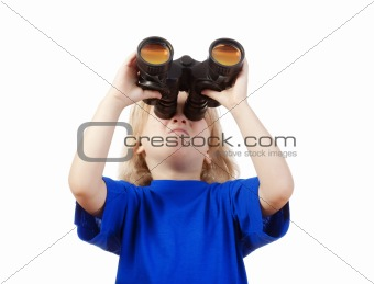 boy with long blond hair in blue top looking through binoculars - isolated on white