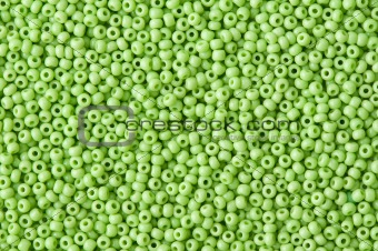 background of green beads close up