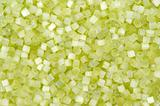 background of green decorative plastic craft beads