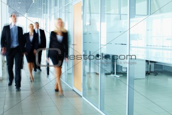 Businesspeople in corridor