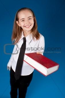 Little girl giving a book