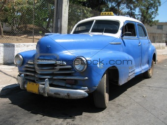 An old blue taxi in Cuba