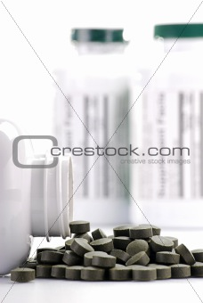 Dietary supplement tablets and containers