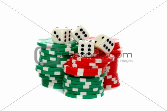 Poker chips stacked and dice on a white background.