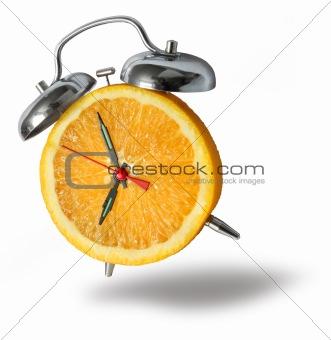 Orange alarm clock ringing