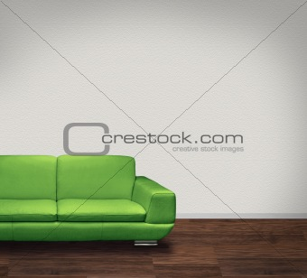 Green leather sofa in white room