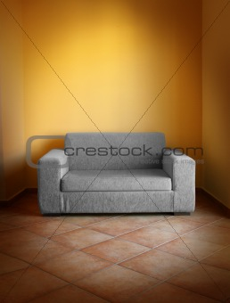 Gray sofa yellow wall