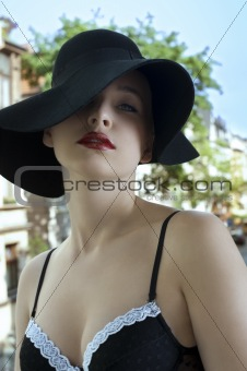portrait of sensual elegant woman in black hat