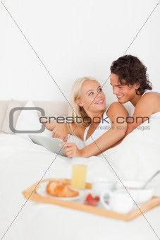 Portrait of a lovely couple using a tablet computer
