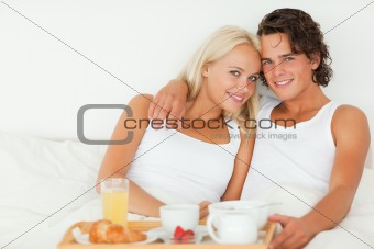 Lovely couple eating breakfast