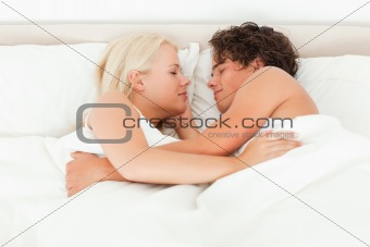Couple sleeping facing each other