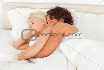 Calm couple hugging while sleeping