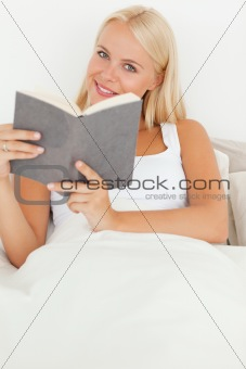 Portrait of a smiling woman holding a book