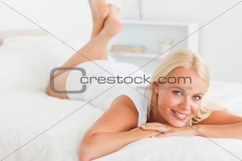 Cute woman lying on her bed