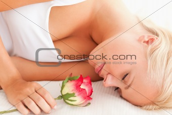 Close up of a calm woman with a flower