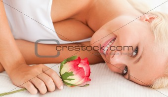 Close up of a lovely woman with a flower