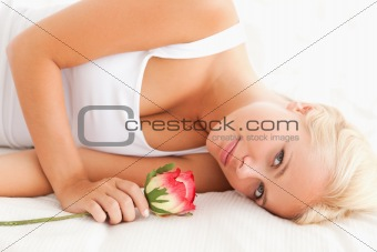Close up of a quiet woman with a flower
