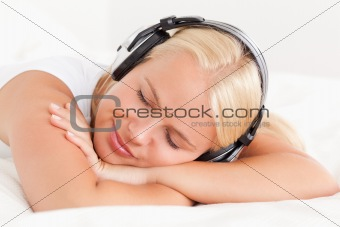 Close up of a quiet woman enjoying some music