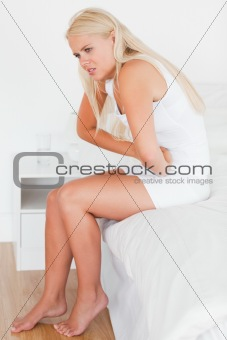 Portrait of a woman having a stomachache