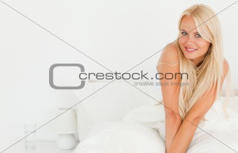 Blonde woman smiling at the camera