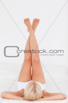 Woman lifting her legs up