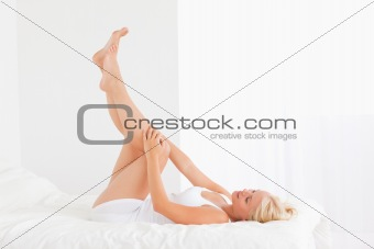 Fit woman with the legs up