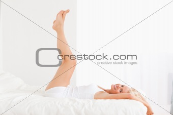 Smiling woman with the legs up