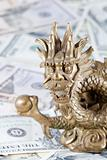 Gold dragon against dollars
