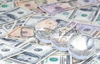 Three crystal spheres against money