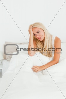 Beautiful woman sitting on her bed