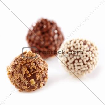three chocolate truffles