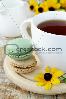 french dessert   macaroons and a cup of tea
