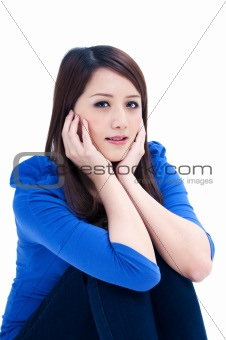 Attractive young woman with hands on face