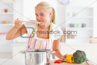 Blonde woman tasting her meal