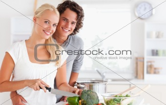Beautiful couple cooking